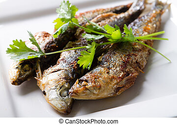 fried sardine on plate