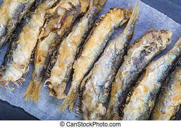 Fried sardines on a slate background - Fried sardines or...
