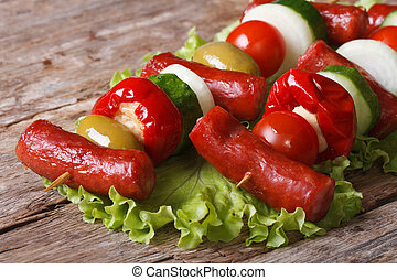 fried sausage with fresh vegetables on skewers horizontal