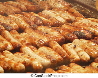 fried sausages - quite a lot of grilled sausages on a roast....