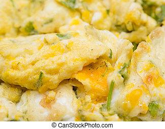fried scrambled eggs as a background. macro