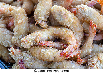 Fried shrimp deep-fried is a street food in local market in Thailand, closeup. Thai food