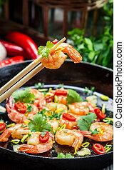 Fried shrimp with fresh herbs
