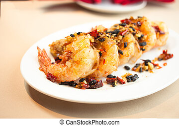 Fried shrimp with spices on dish