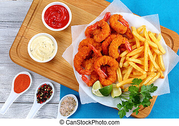 Fried Shrimps, lime wedges, french fries
