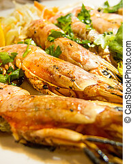 fried shrimps on a plate with herbs