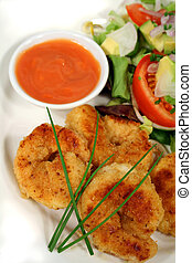Fried shrimps with dipping sauce and salad.