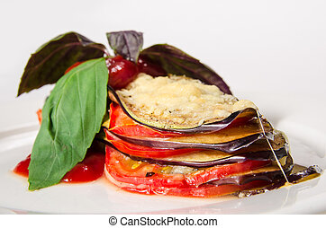 Fried sliced eggplant with chili sauce and herbs on white plate background