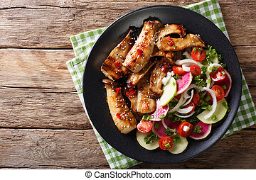 Fried spicy King Brown Mushroom with salad of radish and tomato close-up. horizontal top view