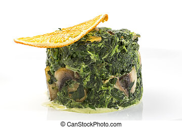 fried spinach decorated with a slice of orange