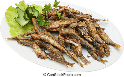 fried sprats with lettuce on plate