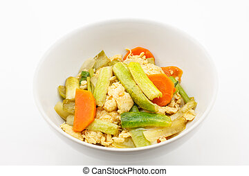 Fried stir cucumber with egg and vegetable for vegetarian on...