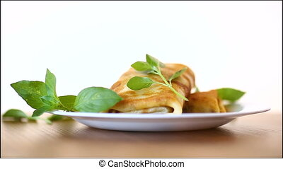 fried thin pancakes stuffed on a white background