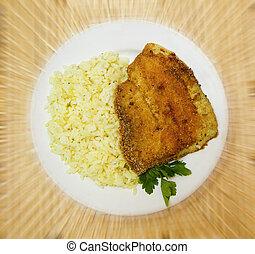 fried tilapia with rice garnish