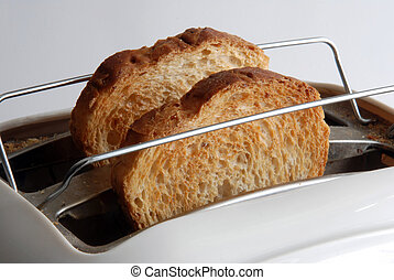 fried toasts popping out of the toaster