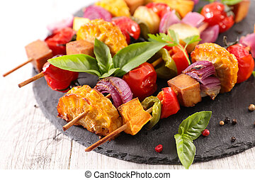 fried vegetable skewer with corn, onion, tomato and tofu