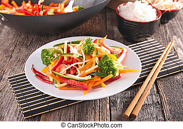 fried vegetable with chopsticks