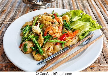 Fried vegetables and seafood in sauce in Thailand