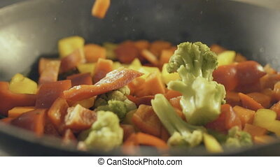 Fried vegetables in a pan, slow motion - Fried vegetables in...