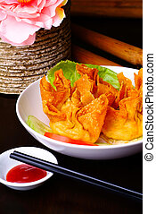 Fried wantons on the background