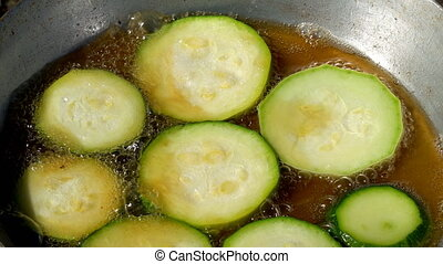 Fried zucchini in frying pan
