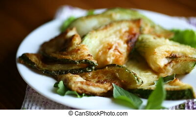 fried zucchini seasoned with dill in a bowl