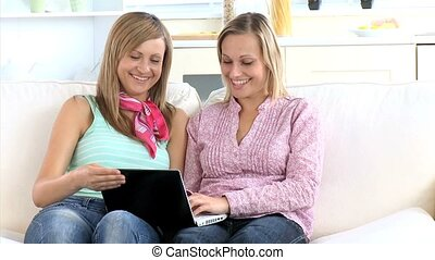 friend showing photo with laptop