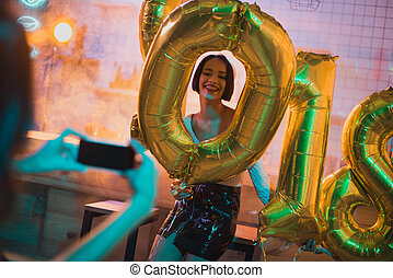 african american woman with balloons