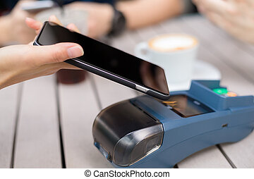 Friend using cellphone to pay