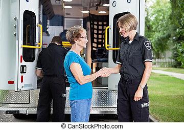 Friendly Ambulance Worker - Ambulance staff shaking hands...