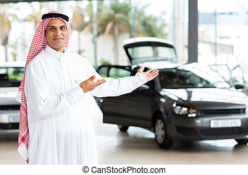 arabian car salesman doing welcoming gesture