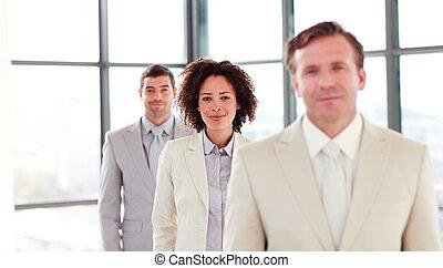 Friendly attractive businesswoman in a line