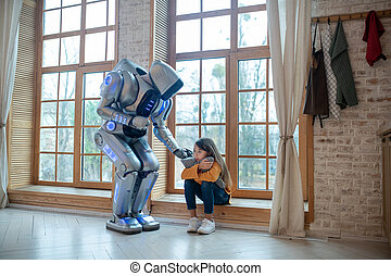Robot supporting a girl touching her shoulder