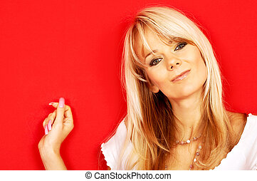 friendly blond - image of friendly blond over red background