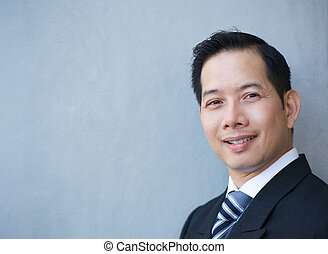 Friendly businessman smiling