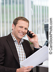 Friendly businessman talking on his mobile