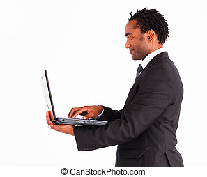 Friendly businessman working on laptop