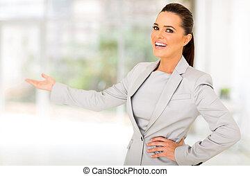 businesswoman doing welcoming gesture