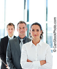Friendly businesswoman in front of her team