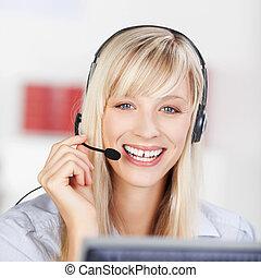 Friendly businesswoman wearing a headset
