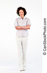 Friendly businesswoman with crossed arms in front of the camera