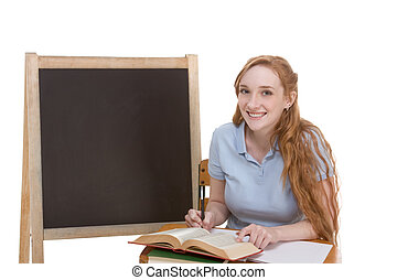 Friendly Caucasian college student by blackboard