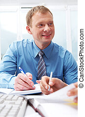 Friendly chief  - Portrait of young manager while talking