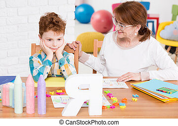 Friendly child therapist trying to reach the boy's mind -...