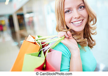 Friendly consumer - Portrait of happy girl with shopping ...