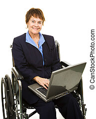 Pretty, smiling businesswoman in a wheelchair working on her laptop computer. Isolated.