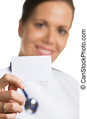 friendly doctor with a blank white business card