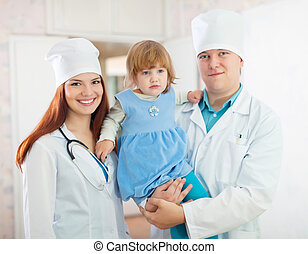 doctors with baby girl in the clinic