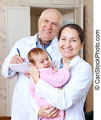 friendly doctors with little baby