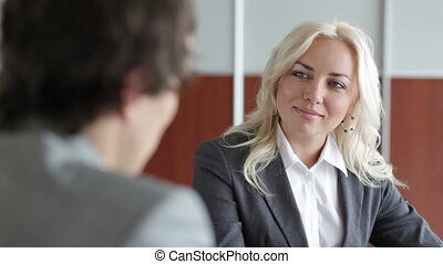 Friendly employer interviewing a potential candidate for a...